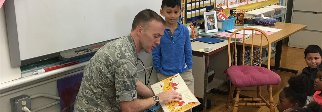 CC students are listening attentively to our Veteran Guest Reader.